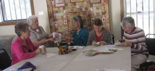 Photo of Stitch Gatherers Working on Project